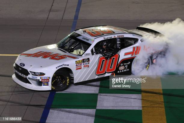 Cole Custer driver of the Haas Automation Ford celebrates with a burnout after winning the NASCAR Xfinity Series Alsco 300 at Kentucky Speedway on...
