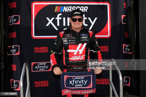 Cole Custer driver of the Haas Automation Ford celebrates with the NASCAR Xfinity Series Pole Award following qualifying for the NASCAR Xfinity...