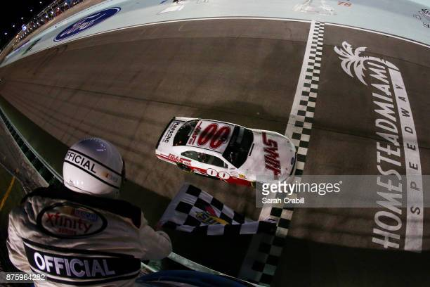 Cole Custer driver of the Haas Automation Ford crosses the finish line to win the NASCAR XFINITY Series Championship Ford EcoBoost 300 at...