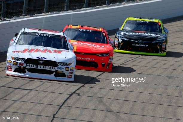 Cole Custer driver of the Haas Automation Ford leads a pack of cars during the NASCAR XFINITY Series US Cellular 250 Presented by American Ethanol at...