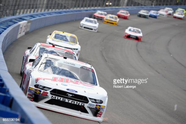Cole Custer driver of the Haas Automation Ford leads a pack of cars during the NASCAR Xfinity Series Roseanne 300 at Auto Club Speedway on March 17...