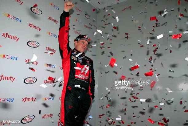 Cole Custer driver of the Haas Automation Ford poses for a photo at the XFINITY fan zone after qualifying for the NASCAR XFINITY Series Rinnai 250...