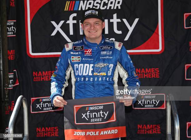 Cole Custer driver of the Haas Automation Ford poses with the pole award after qualifying for the NASCAR Xfinity Series DC Solar 300 at Las Vegas...