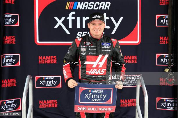 Cole Custer driver of the Haas Automation Ford poses with the Pole Award following qualifying for the NASCAR Xfinity Series Allied Steel Buildings...