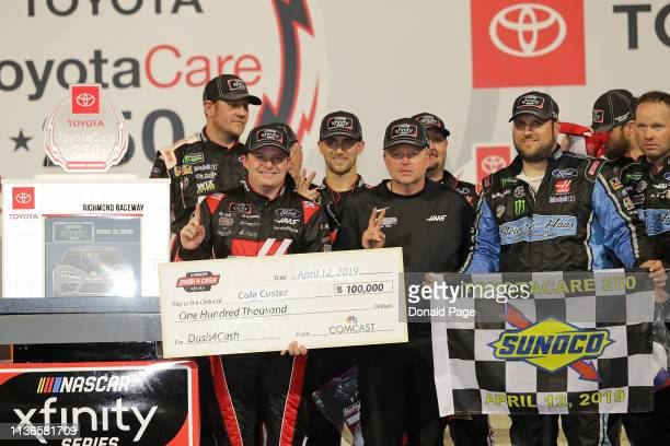 Cole Custer driver of the Haas Automation Ford poses with the trophy after winning the NASCAR Xfinity Series ToyotaCare 250 at Richmond Raceway on...