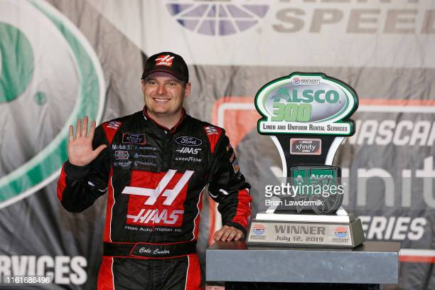 Cole Custer driver of the Haas Automation Ford poses with the trophy in Victory Lane after winning the NASCAR Xfinity Series Alsco 300 at Kentucky...