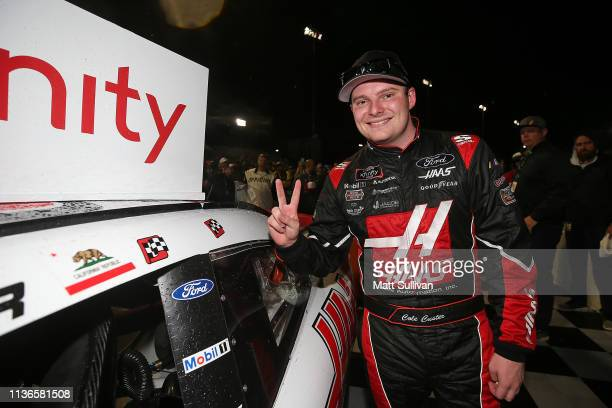 Cole Custer driver of the Haas Automation Ford poses with the winners sticker after winning the NASCAR Xfinity Series ToyotaCare 250 at Richmond...