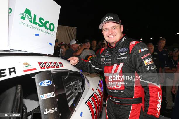 Cole Custer driver of the Haas Automation Ford poses with the winner's sticker in Victory Lane after the NASCAR Xfinity Series Alsco 300 at Kentucky...