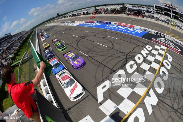 Cole Custer driver of the Haas Automation Ford Ryan Truex driver of the Phantom Fireworks Chevrolet and Kyle Busch driver of the Comcast Salute to...