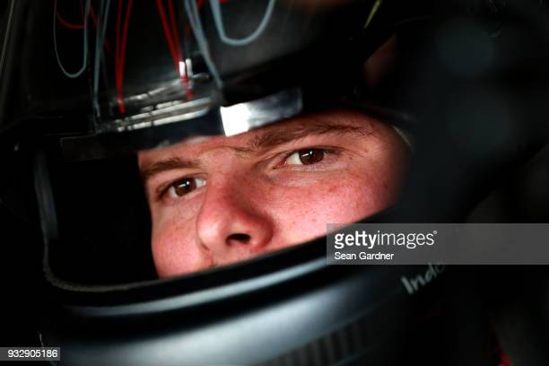 Cole Custer driver of the Haas Automation Ford sits in his car during practice for the NASCAR Xfinity Series Roseanne 300 at Auto Club Speedway on...
