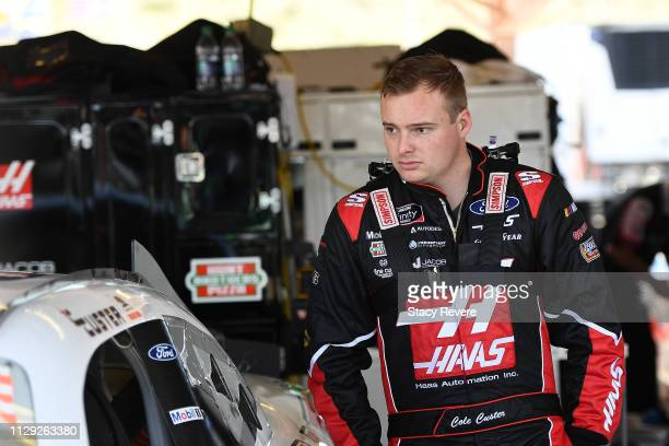 Cole Custer driver of the Haas Automation Ford stands in the garage during practice for the NASCAR XFINITY Series iK9 Service Dog 200 at ISM Raceway...