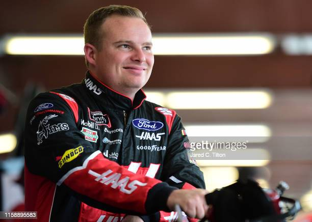 Cole Custer driver of the Haas Automation Ford stands in the garage area during practice for the NASCAR Xfinity Series Camping World 300 at...