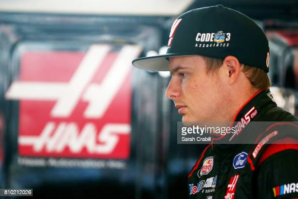 Cole Custer driver of the Haas Automation Ford stands in the garage during practice for the NASCAR XFINITY Series Alsco 300 at Kentucky Speedway on...