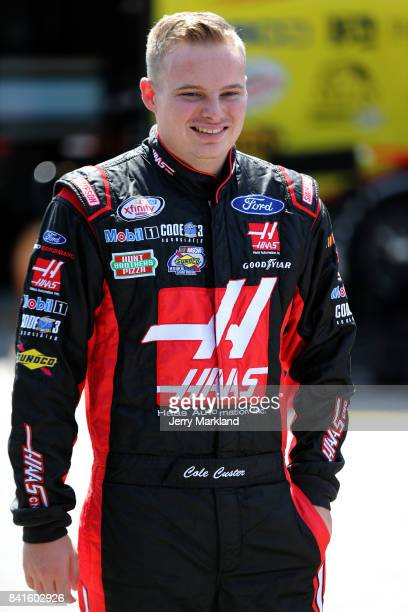 Cole Custer driver of the Haas Automation Ford stands in the garage area during practice for the NASCAR XFINITY Series Sports Clips Haircuts VFW 200...