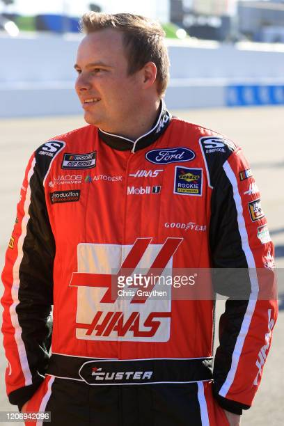 Cole Custer driver of the Haas Automation Ford stands on the grid during the NASCAR Cup Series 62nd Annual Daytona 500 at Daytona International...