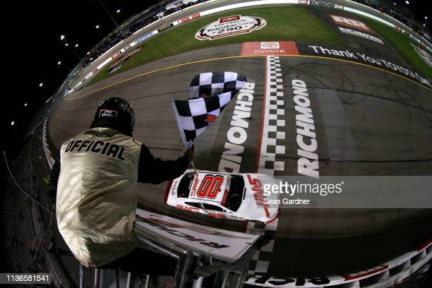 Cole Custer driver of the Haas Automation Ford takes the checkerd flag to win the NASCAR Xfinity Series ToyotaCare 250 at Richmond Raceway on April...