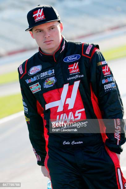 Cole Custer driver of the Haas Automation Ford walks on the grid during qualifying for the NASCAR XFINITY Series Rinnai 250 Atlanta Motor Speedway on...