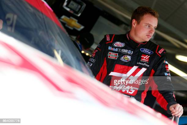 Cole Custer driver of the Haas/Code 3 Associates Ford stands in the garage area during practice for the NASCAR XFINITY Series Kansas Lottery 300 at...