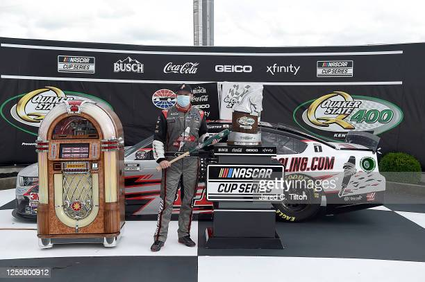 Cole Custer driver of the HaasToolingcom Ford celebrates in Victory Lane after winning the NASCAR Cup Series Quaker State 400 Presented by Walmart at...