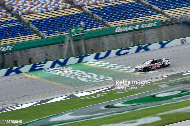 Cole Custer, driver of the HaasTooling.com Ford, crosses the finish line to win the NASCAR Cup Series Quaker State 400 Presented by Walmart at...