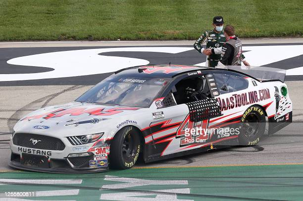 Cole Custer driver of the HaasToolingcom Ford is congratulated by Kevin Harvick driver of the Hunt Brothers Pizza Ford after winning the NASCAR Cup...