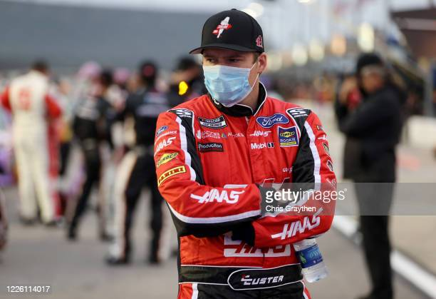 Cole Custer driver of the HaasToolingcom Ford stands on the grid prior to the NASCAR Cup Series Toyota 500 at Darlington Raceway on May 20 2020 in...