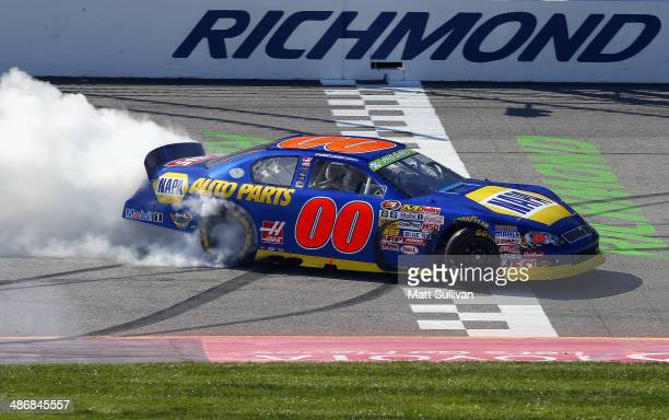Cole Custer driver of the NAPA Auto Parts/Haas Automation Chevrolet does a burnout after winning the NASCAR KN Pro Series East Blue Ox 100 at...