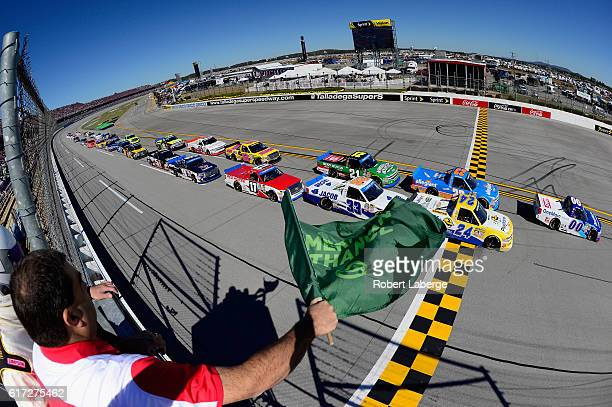 Cole Custer driver of the OneMain Chevrolet leads the field past the green flag to start the NASCAR Camping World Truck Series fred's 250 at...