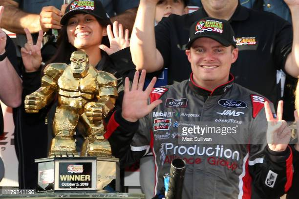 Cole Custer driver of the Production Alliance Group Ford celebrates in Victory Lane after winning the NASCAR Xfinity Series Use Your Melon Drive...