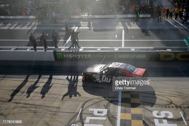 Cole Custer driver of the Production Alliance Group Ford celebrates with a burnout after winning the NASCAR Xfinity Series Use Your Melon Drive Sober...