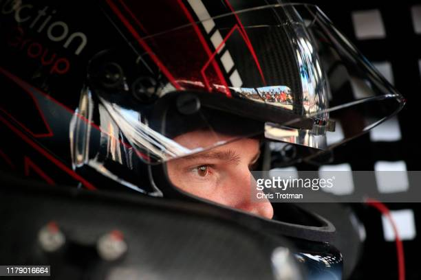 Cole Custer driver of the Production Alliance Group Ford looks on from the garage during practice for the NASCAR Xfinity Series Use Your Melon Drive...