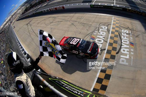 Cole Custer driver of the Production Alliance Group Ford takes the checkered flag to win the NASCAR Xfinity Series Use Your Melon Drive Sober 200 at...