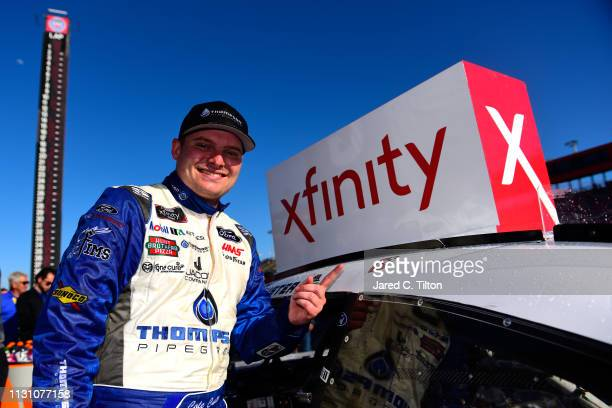 Cole Custer driver of the Thompson Pipe/Haas CNC Ford celebrates in Victory Lane after putting the Winner's Sticker on his car during the NASCAR...