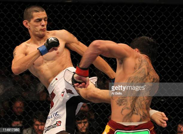 Cole Escovedo kicks Renan Barao during their bantamweight fight at UFC 130 at the MGM Grand Garden Arena on May 28, 2011 in Las Vegas, Nevada.