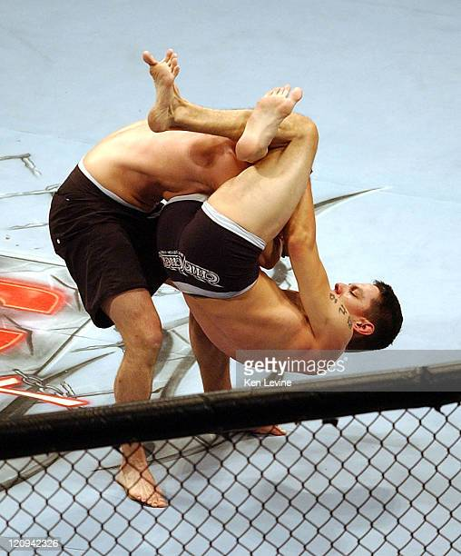 Cole Escovedo wraps his legs around the head and neck of Randy Spence and renders him unconscious during the IFC Caged Combat fights at the E Center...