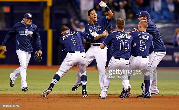 Cole Figueroa of the Tampa Bay Rays is congratulated by teammates after hitting a walk-off RBI double in the ninth inning of a baseball game against...