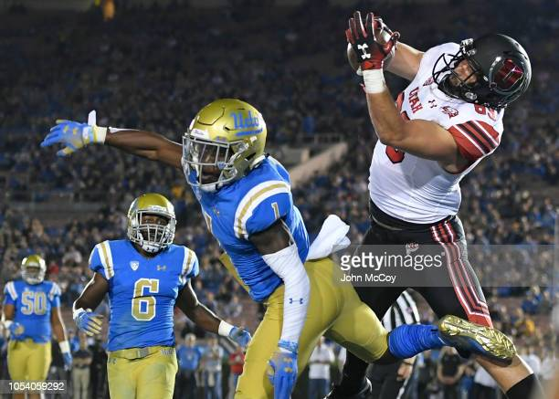 Cole Fotheringham of the Utah Utes catches a touchdown pass over Darnay Holmes of the UCLA Bruins in the second quarter at the Rose Bowl on October...