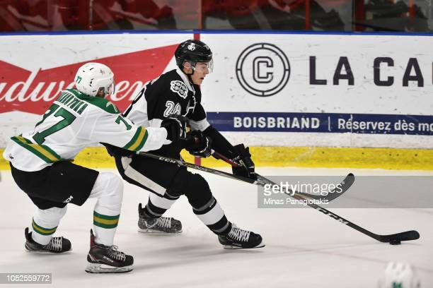Cole Fraser of the BlainvilleBoisbriand Armada skates the puck against Jeremie Biakabutuka of the ValdOr Foreurs during the QMJHL game at Centre...