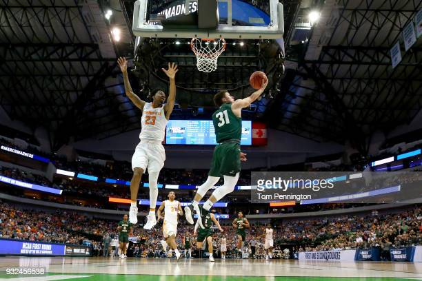 Cole Gentry of the Wright State Raiders goes up for a shot against Jordan Bowden of the Tennessee Volunteers in the first half in the first round of...