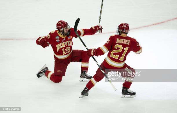 Cole Guttman of the Denver Pioneers celebrates his goal against the Massachusetts Minutemen during game two of the 2019 NCAA Division I Men's Hockey...