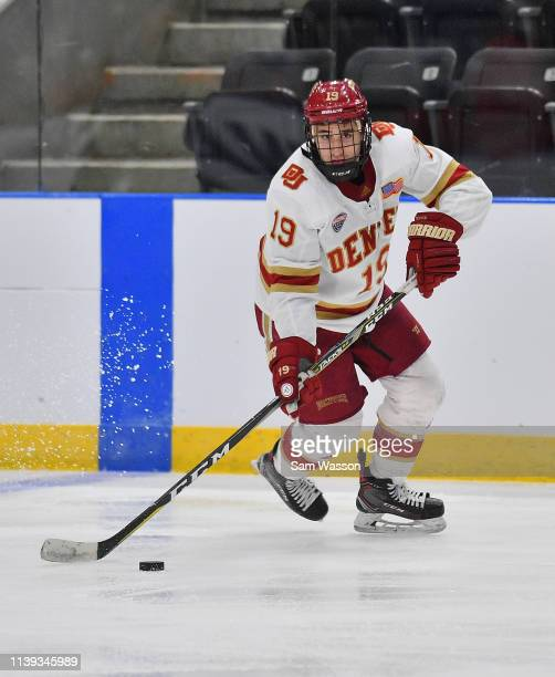 Cole Guttman of the Denver Pioneers skates with the puck during his team's NCAA Division I Men's Ice Hockey West Regional Championship Semifinal game...