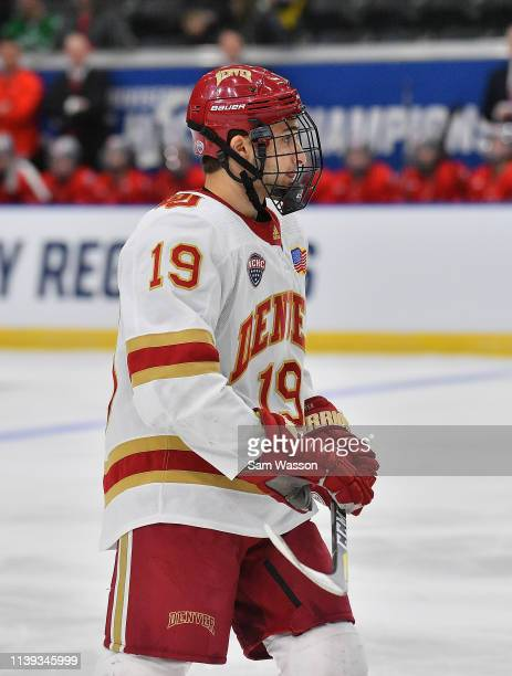 Cole Guttman of the Denver Pioneers stands on the ice during his team's NCAA Division I Men's Ice Hockey West Regional Championship Semifinal game...
