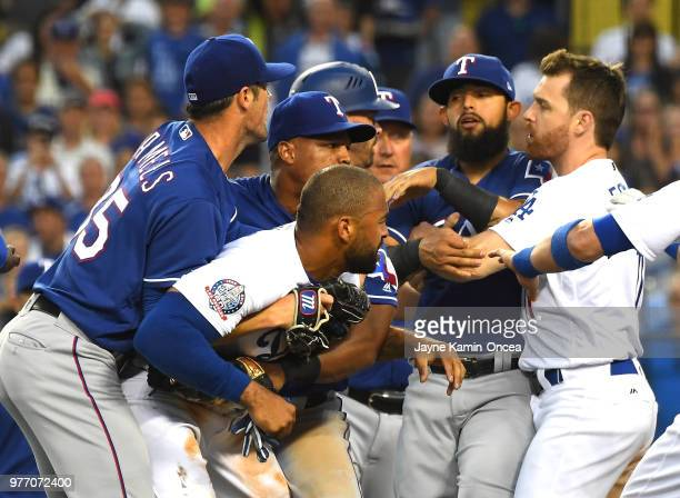 Cole Hamels and Adrian Beltre of the Texas Rangers hold on to Matt Kemp of the Los Angeles Dodgers as they separate players including Rougned Odor of...