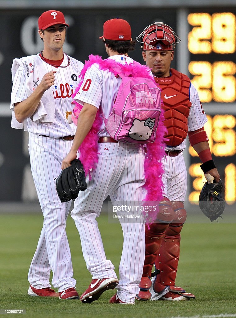 Cole Hamels #35 and Carlos Ruiz #51 of the Philadelphia Phillies greet teammate Michael Stutes #40 on before the game against the Washington Nationals at Citizens Bank Park on August 12, 2011 in Philadelphia, Pennsylvania.