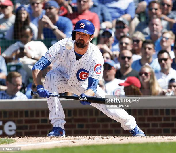 Cole Hamels of the Chicago Cubs bunts during the seventh inning against the St Louis Cardinals at Wrigley Field on June 07 2019 in Chicago Illinois