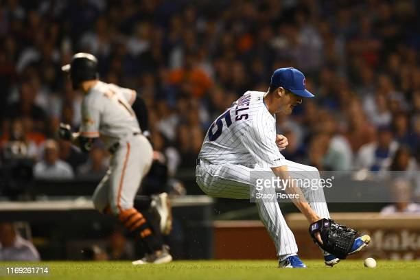 Cole Hamels of the Chicago Cubs fields a ground ball hit by Kevin Pillar of the San Francisco Giants during the sixth inning at Wrigley Field on...