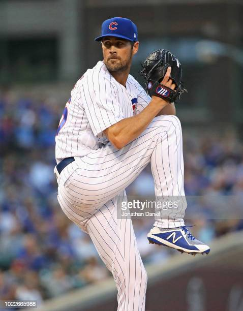 Cole Hamels of the Chicago Cubs pitches on his way to a complete game win over the Cincinnati Reds at Wrigley Field on August 23 2018 in Chicago...