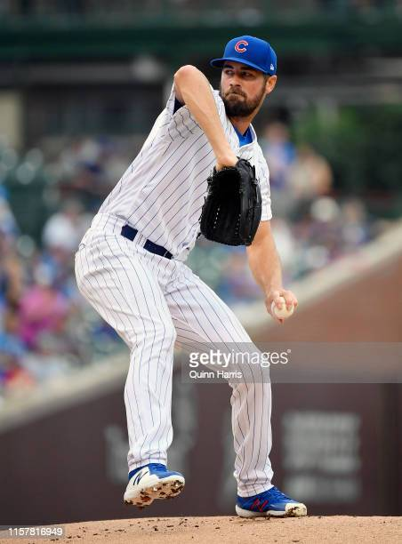 Cole Hamels of the Chicago Cubs pitches the ball in the first inning against the New York Mets at Wrigley Field on June 23 2019 in Chicago Illinois