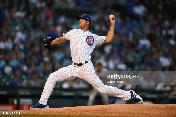 Cole Hamels of the Chicago Cubs throws a pitch during the first inning against the San Francisco Giants at Wrigley Field on August 20 2019 in Chicago...