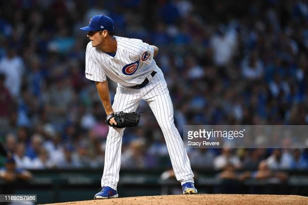Cole Hamels of the Chicago Cubs throws a pitch during the second inning against the San Francisco Giants at Wrigley Field on August 20 2019 in...